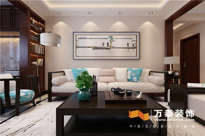 客厅影视墙采用简单瓷砖和不锈钢条收口客厅沙发背景采用自家装裱挂图片