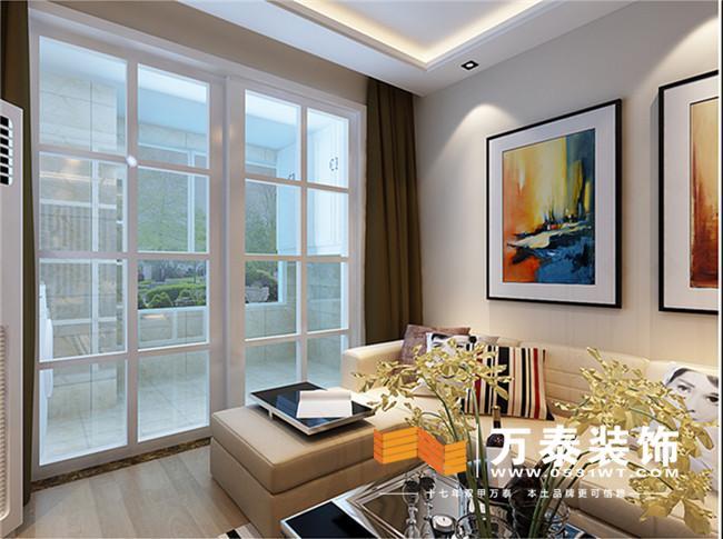 卡色的影视墙搭上浅色的木地板这样显得家里比较有层次感和现代感.