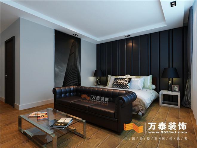 木地板上墙的方式加上黑胡桃木色家具的搭配使整个空